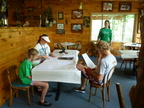 Reviewing consent forms for a kayak trip on the Nolichucky River