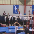 A blurry Brandon practicing on the parallel bars
